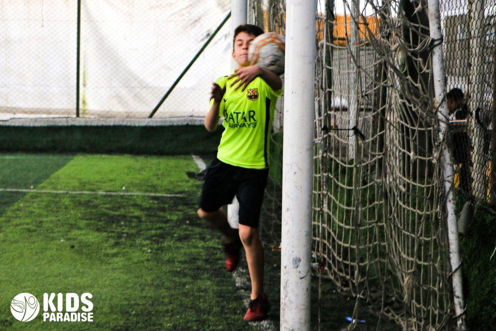 Children play football at KP academy in Antakya